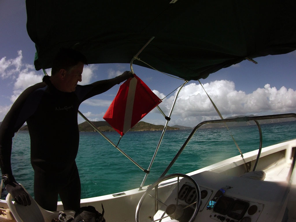 Rich Myers (research assistant) holding dive flag